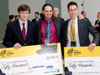 Entrepreneurs holding awards checks from Clean Energy Trust