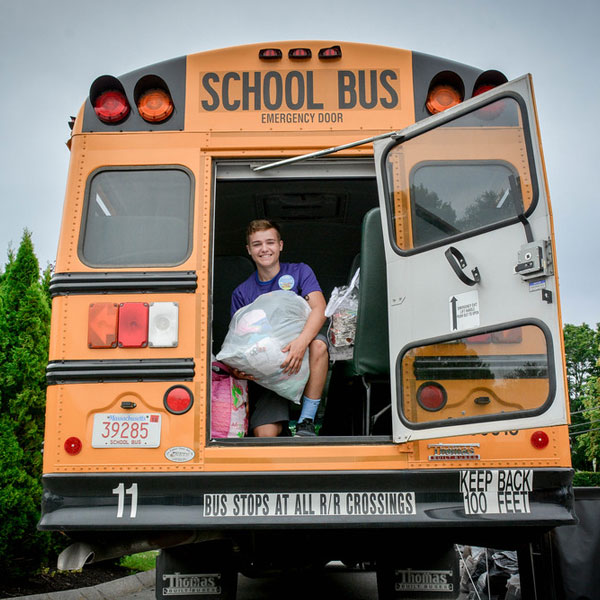 Bus filled with donations for school aged children