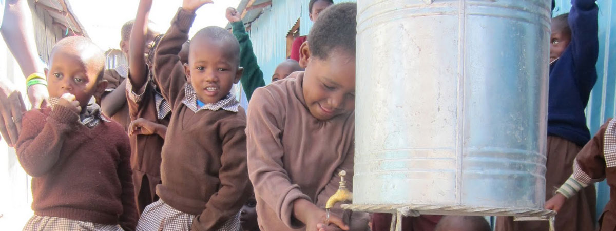 kids using a clean water station