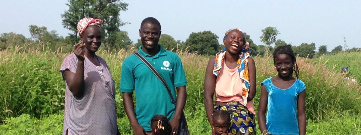 Family of farmers standing in a field