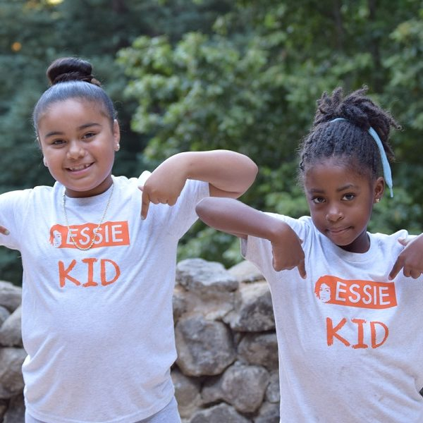 Two young girls wear Essie Kid t-shirts