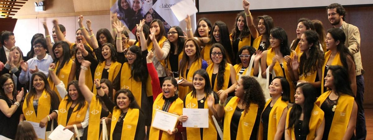 A large group of women celebrate their graduation
