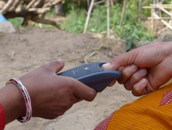 Finger being scanned in village