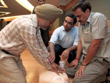 Three Indian men learn CPR