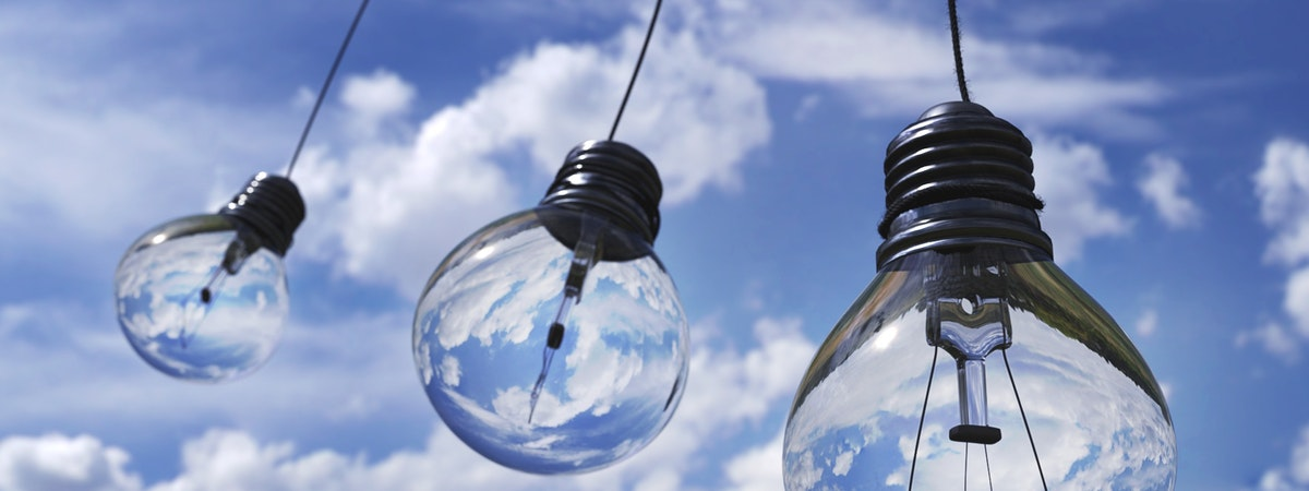 Lightbulbs hanging with blue sky in the background