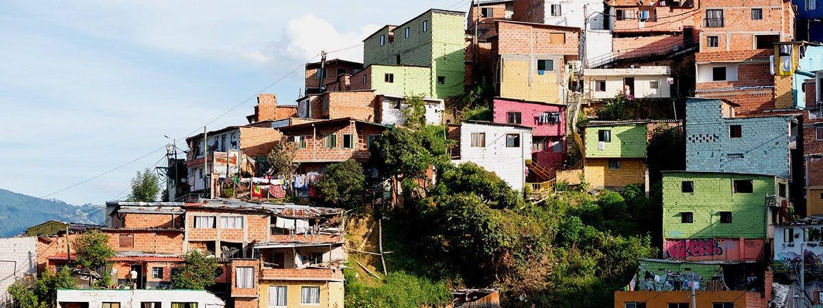 Colorful homes are built into a hillside in Colombia