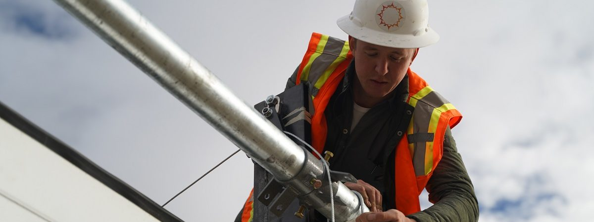 Angelo Campus adjusts an electrical wire